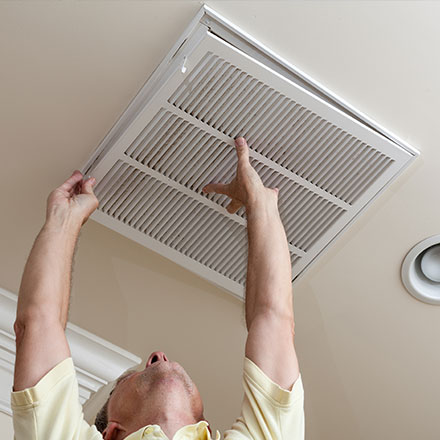 Changing the filter on an HVAC return